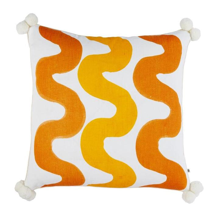 "'Curves' cushion in Saffron Gold, $220, [Bonnie and Neil](https://bonnieandneil.com.au/collections/cushions-1/products/curve-saffron-gold-60cm|target=""_blank""