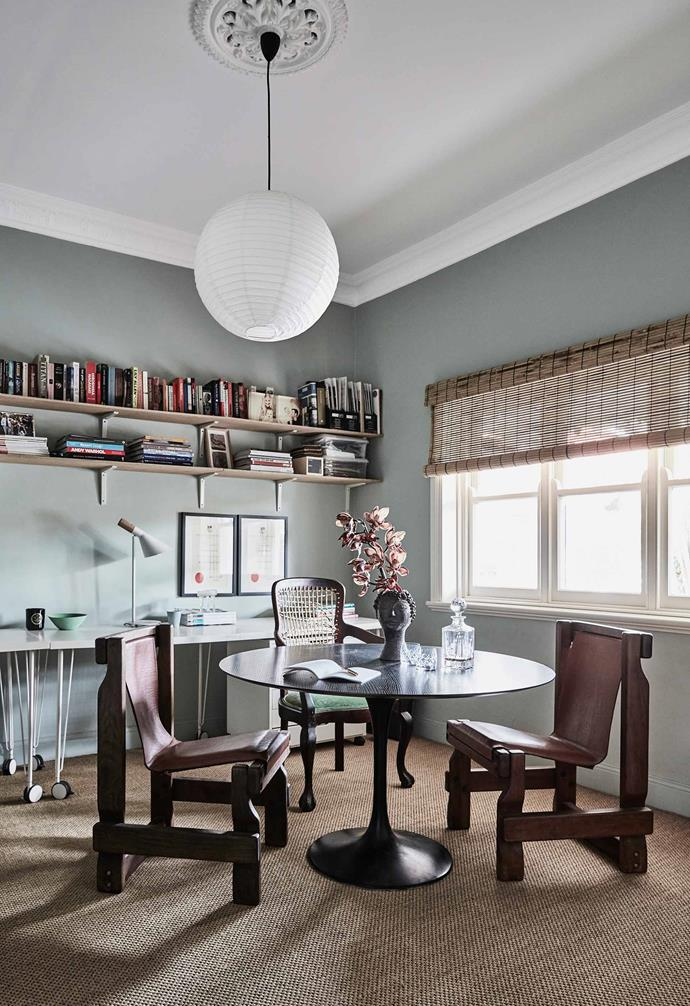 "**Study**  ""This is my home office,"" says Kristy. ""It's also where I keep random furniture and styling finds I've collected over the years."" Wall colour, Dulux Mossa. Saarinen table with antique and op-shop chairs. Desking, [Ikea](https://www.ikea.com/au/en/). Shelves, [Bunnings](https://www.bunnings.com.au/). The flooring is sisal and the blinds are bamboo. Vase, an old family piece."