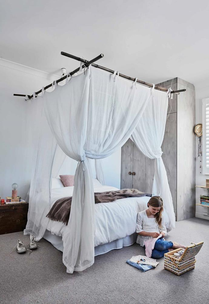 **Ella's room** Suspended from the ceiling is a net on a bamboo structure from [Mosquito Nets Online](https://www.mosquito-nets.com.au/). The wardrobe has a timber-look laminate finish; leather handles from [MadeMeasure](https://www.mademeasure.com/). Linen, [Cultiver](https://cultiver.com.au/).