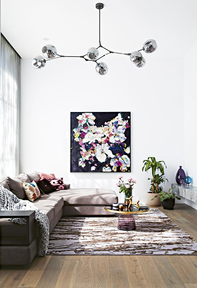 """A colourful Alessandro Ljubicic artwork is the crowning feature in the living room of this [extended Edwardian home](https://www.homestolove.com.au/a-modern-extension-revived-this-century-old-edwardian-home-7147