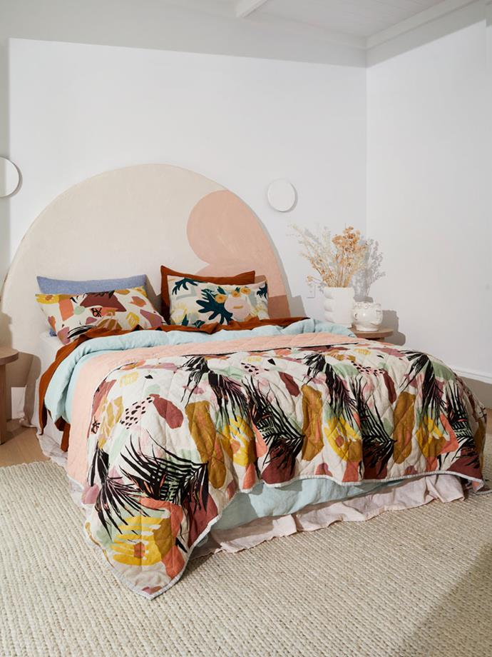 """A vibrant throw and colourful cushions add a playful touch to the bedroom in this incredible bedroom featuring bedding from [Greenhouse Interiors](https://greenhouseinteriors.com.au/