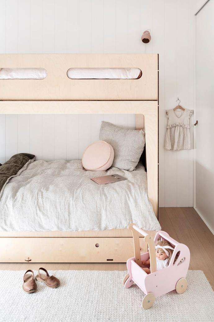 "Plywood bunk beds have maximised space for two sisters in this [Scandinavian-style beach house](https://www.homestolove.com.au/scandinavian-style-beach-house-20995|target=""_blank"") on the Great Ocean Road."