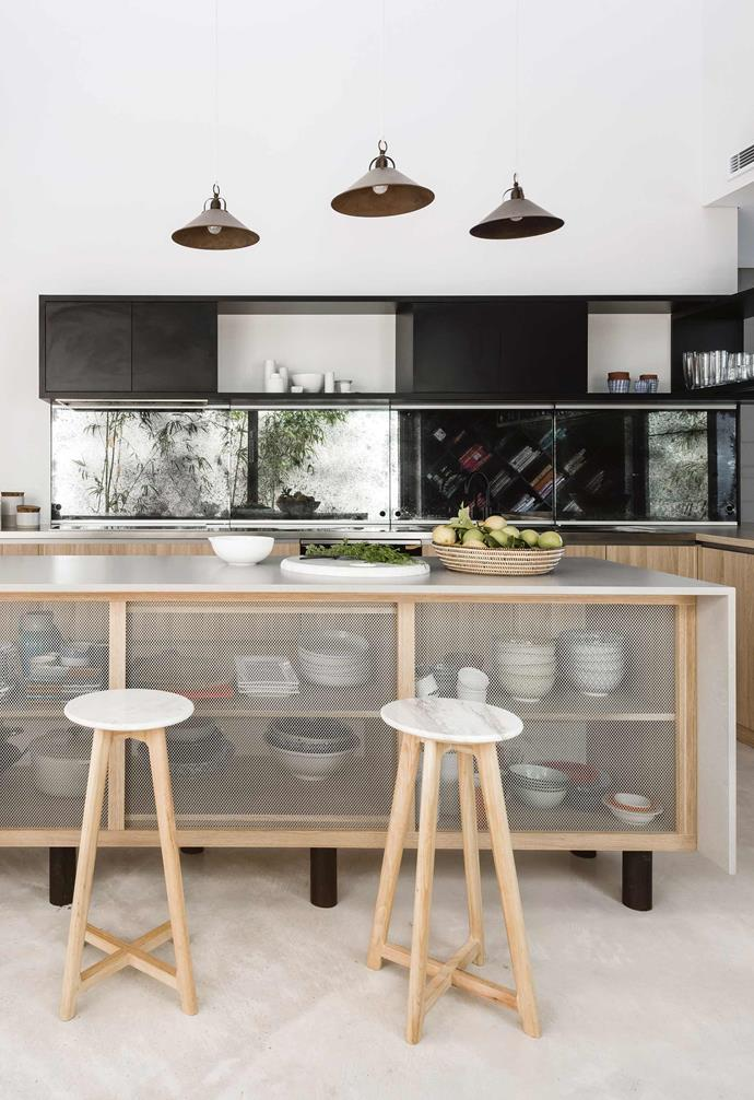 "Light from a rear courtyard brings the well-planned kitchen in this [Fremantle home](https://www.homestolove.com.au/wabi-sabi-meets-warehouse-style-living-in-this-perth-home-18946|target=""_blank"") to life."