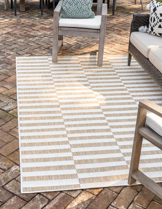 "Outdoor Striped Rug, $279, [AU Rugs](https://www.aurugs.com/taupe-5x8-outdoor-striped-area-rug-33148778?gclid=CjwKCAjwhOD0BRAQEiwAK7JHmJinqaDWriHqKwR6gid8xnNpE0y7cScS6Ra0zPp3hDrObxFClCqcYhoCA30QAvD_BwE|target=""_blank""