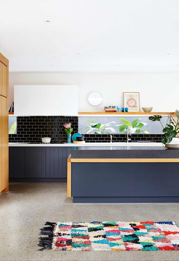 "The couple were thrilled to be able to retain the bricks of their original home, which now form a feature in the entry, but other than this nod to the past, the couple have embraced a contemporary interior fit-out to suit their lifestyle.<br><br>**KItchen** The grey cabinetry in [Dulux](https://www.dulux.com.au/|target=""_Blank""