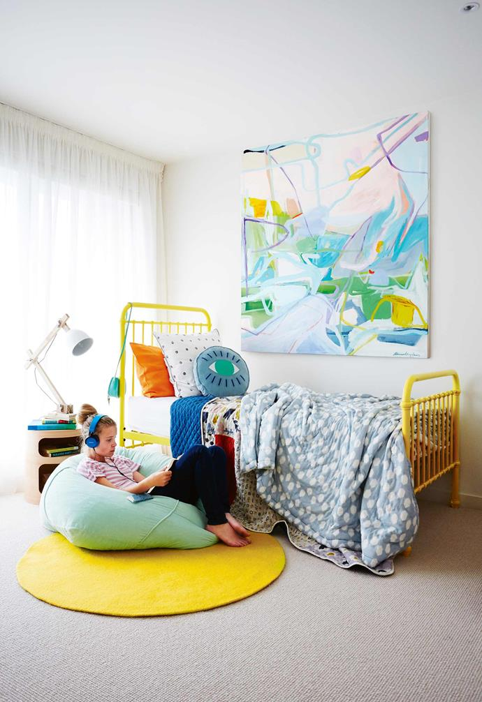 Floor-to-ceiling glass windows allow the outside into the home, meaning this family can enjoy all of the seasons that Melbourne has on offer.<br><br>**Molly's room** The perfect teenage retreat, this room is a joyously coloured space. The vibrant bed frames the room and is adorned in a mix of Gorman, Castle and Marks & Spencer bedlinen. Artwork: *Teatime Summer* by Ali McNabney-Stevens.