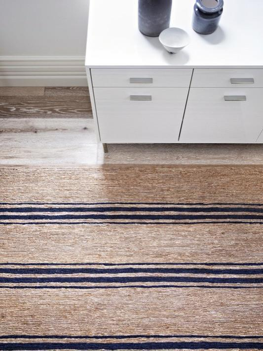 "Indigo Ticking Stripe River, Armadillo Floor Rug, $1,090, [Curious Grace](https://curiousgrace.com.au/collections/armadillo-floor-rugs-for-home-interiors-and-outdoor/products/armadillo-decorator-rugs-earth-collection-river-weave-with-ticking-stripe-natural-and-indigo|target=""_blank""
