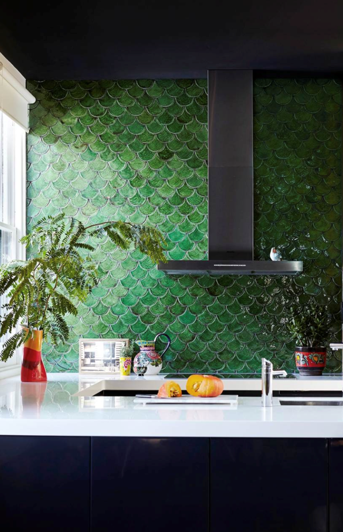 "Olive-green fishscale-patterned tiles add character to the contemporary kitchen in this [Victorian home](http://www.homestolove.com.au/grand-victorian-home-gets-a-colourful-personality-3642|target=""_blank"")."