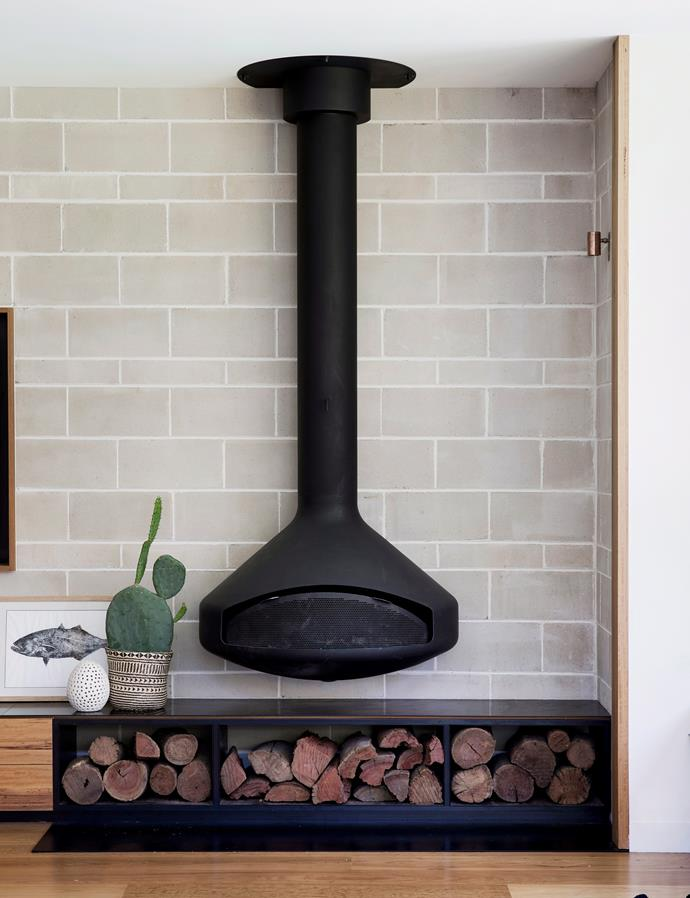 **Stock up on firewood**  <br><br> A tidy stack by the fireplace will double as a statement centrepiece to tie your space together. Chic by day, and by night you can use the wood transform your living room into a cosy and inviting area - just add a plush couch. *Photo: Chris Warnes / Bauersyndication.com.au*