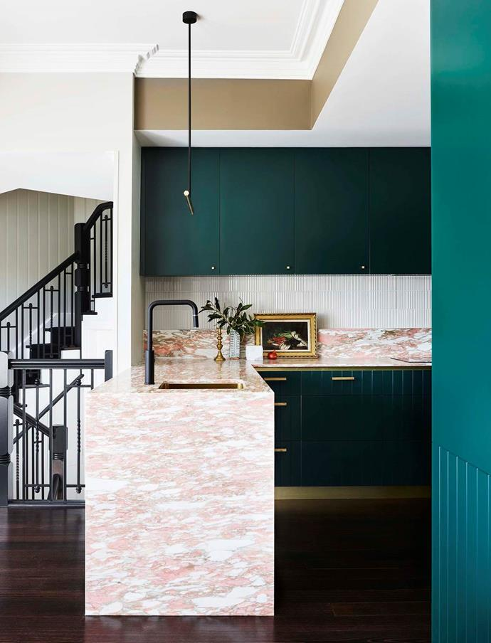 "The grandeur of [this 19th-century chandlery and residence](https://www.homestolove.com.au/revived-heritage-home-with-contemporary-finishes-20495|target=""_blank"") was fully reinstated in the kitchen with deep-sea green washes and fluid pink marble benches."