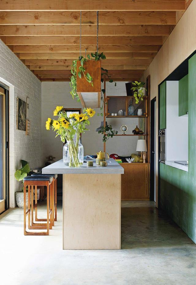 "A small, [sustainable home in Perth](https://www.homestolove.com.au/small-eco-friendly-house-19983|target=""_blank"") creates a sunny atmosphere with injections of yellow and green in their casual kitchen, pared back with reclaimed bricks painted white and rustic wooden joinery."