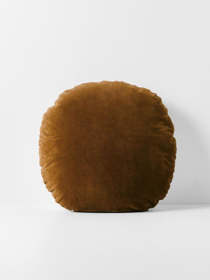 "Luxury Velvet 55cm Round Cushion in Tabacco, $79.95, [Aura Home](https://www.aurahome.com.au/luxury-velvet-55cm-round-cushion-tobacco|target=""_blank"")"