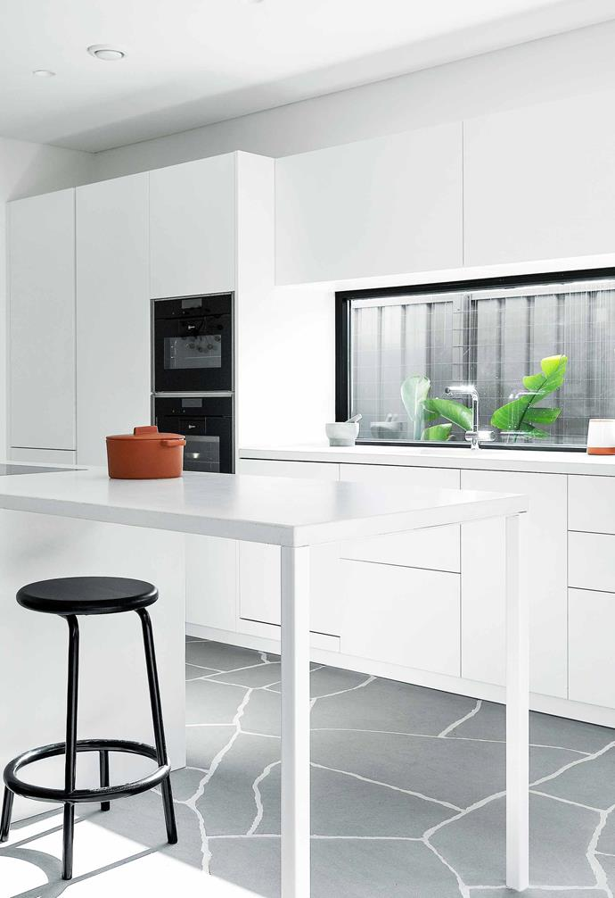 """**Kitchen** In the cooking zone, white concrete benchtops are paired with Arrital matt-white laminate cabinetry by [Retreat Design](https://www.retreatdesignperth.com.au/ target=""""_blank"""" rel=""""nofollow""""). The Les Basic 'Volar' stool in Black, also from [Living Edge](https://livingedge.com.au/ target=""""_blank"""" rel=""""nofollow""""), offers a great spot to perch at the cantilevered bench."""