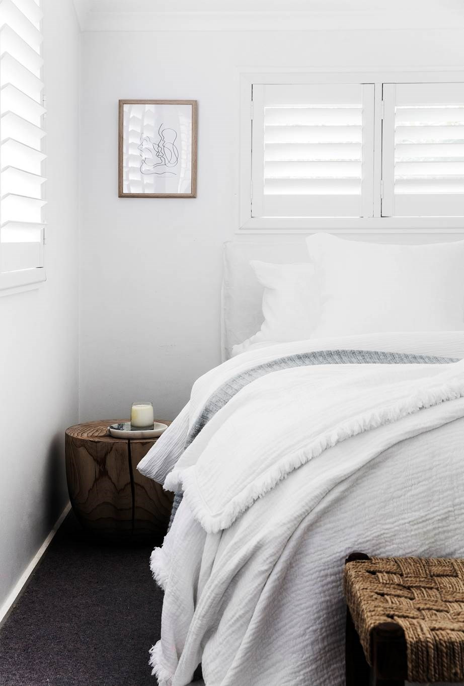 Layers of crisp white cotton sheets and linen throws, this bed a cloud-like aesthetic.