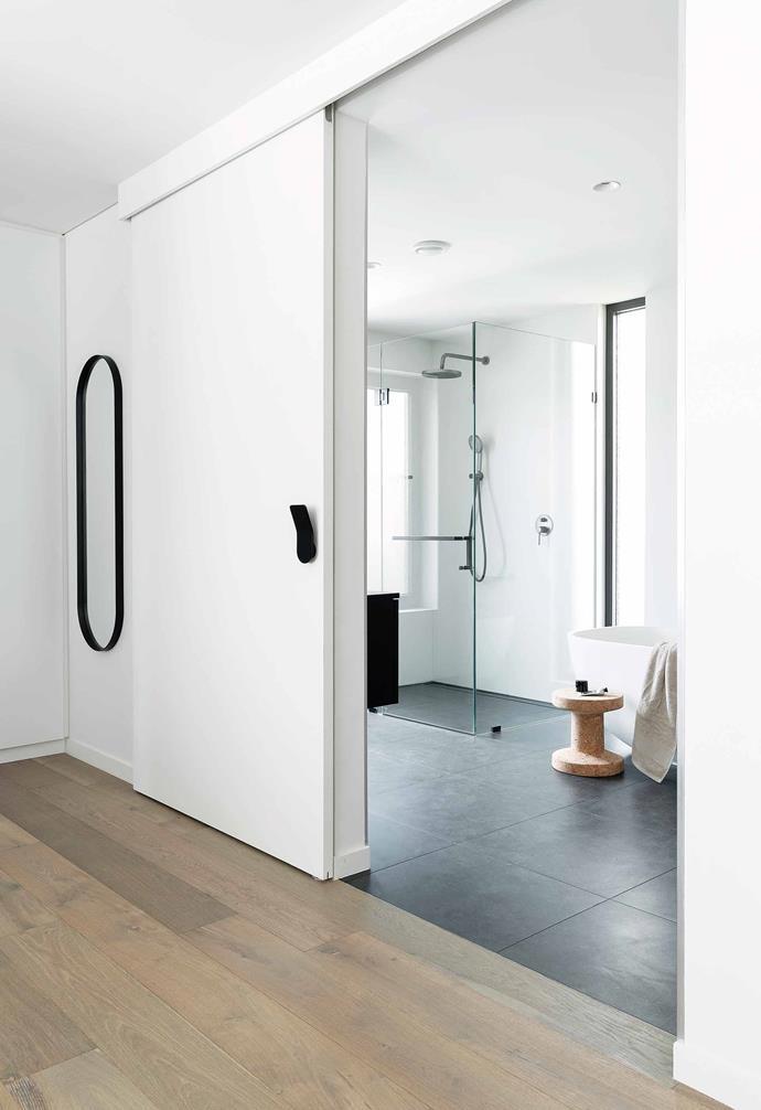 "**Ensuite** This spacious wet area has hardwearing yet smart finishes, including Atlantic Granite picket wall tiles from [Myaree Ceramics](https://myareeceramics.com.au/ target=""_blank"" rel=""nofollow""). Vitra cork stool, [Living Edge](https://livingedge.com.au/ target=""_blank"" rel=""nofollow"")."