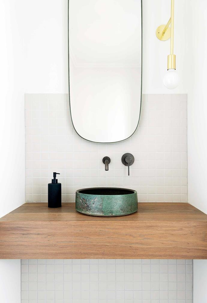 "**Powder room** Highlighting Jason's love of organic materials, the vanity is European oak with a striking Lichen basin by [Lindsey Wherrett Ceramics](https://www.lindseywherrett.com/ target=""_blank"" rel=""nofollow""). A Muuto 'Framed' mirror and [Volker Haug](https://www.volkerhaug.com/ target=""_blank"" rel=""nofollow"") 'Wall Step' light work visually and practically."