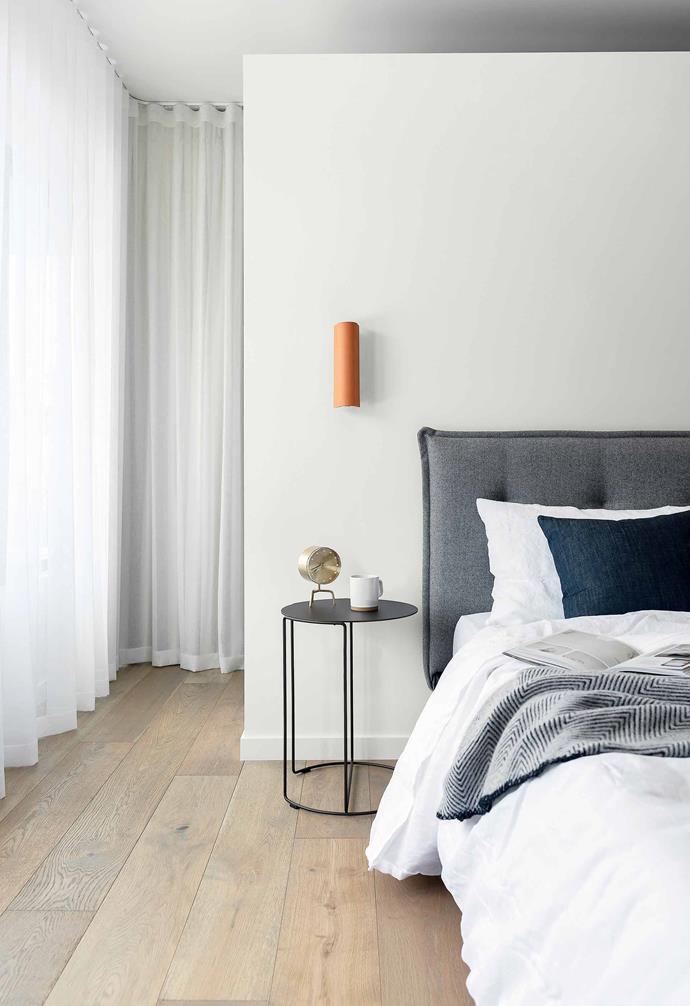 "Main bedroom** ""I used the timber upstairs to create a warmer, cosier feel,"" says Jason. Hampton European oak floorboards, [Woodpecker Flooring](https://www.woodpeckerflooring.com.au/signature-oak-range-2 target=""_blank"" rel=""nofollow""). The [Arthur G](http://www.arthurg.com.au/ target=""_blank"" rel=""nofollow"") 'Austin' bed, layered in luxe Sheridan 'Abbotson' linen, is flanked by a Walter Knoll 'Oki' side table from [Living Edge](https://livingedge.com.au/ target=""_blank"" rel=""nofollow"")."