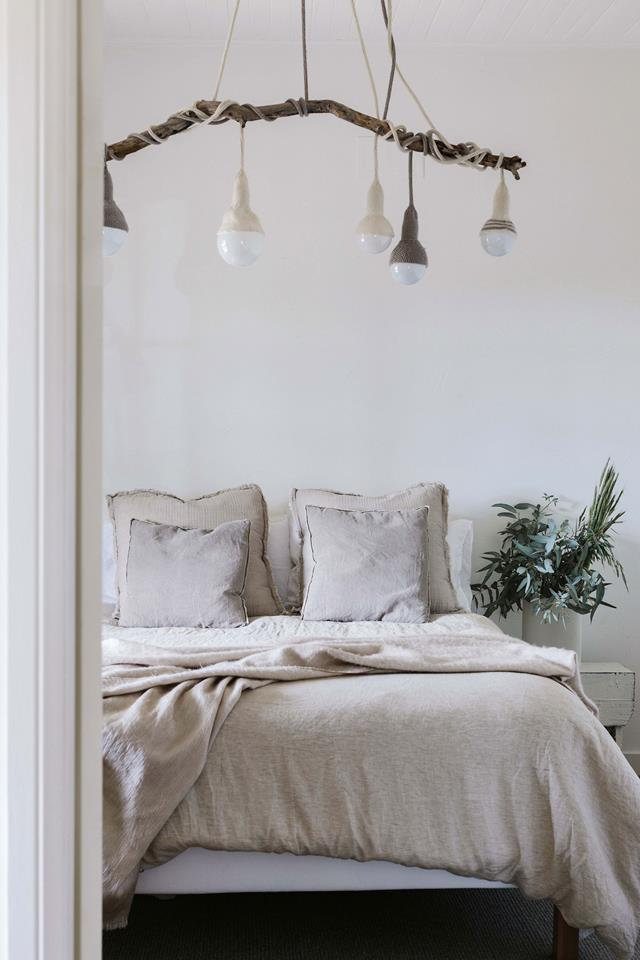 """A subtle mix of natural timber, stone hues and a mix of textures allow this bedroom in a [farm cottage in the Blue Mountains](https://www.homestolove.com.au/farm-cottage-blue-mountains-19902