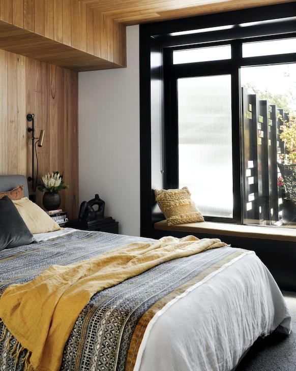 Blackbutt cladding. Wall light, ISM Objects. Bedside table, Ikea.