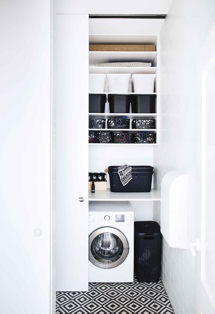 """A clever sliding cavity door hides the compact laundry space in this [relaxed terrace in Paddington](https://www.homestolove.com.au/relaxed-terrace-paddington-18366
