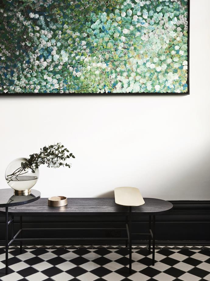 'Palette Table JH7' from Great Dane in the entry with artwork by Evelyn Pultara. 'Aytm' vase from Top3 by Design.