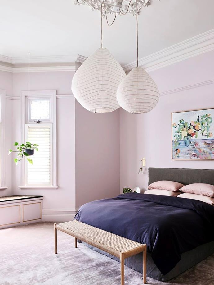 This page An artwork by Helen McCullagh picks up on the main bedroom colours. 'Ici' wall sconce from Articolo. 'Moller' bench from Great Dane.
