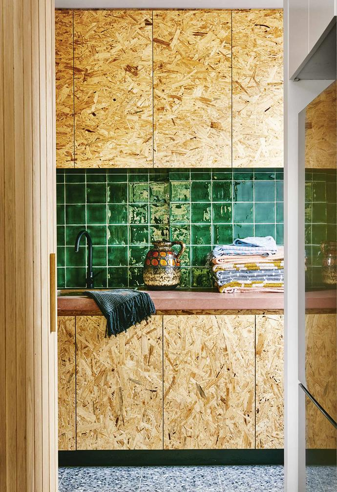 """Forget colour as a decorating tool. Here, it's pure expression. Great wells of light and a completely open living area ensure this small home can carry the punch.<br><br>**Butler's pantry** A kitchen wall with a concealed door hides OSB (oriented strand board) cabinets, another pink concrete benchtop and tiles from [Bespoke Tile & Stone]](https://bespoketileandstone.com/