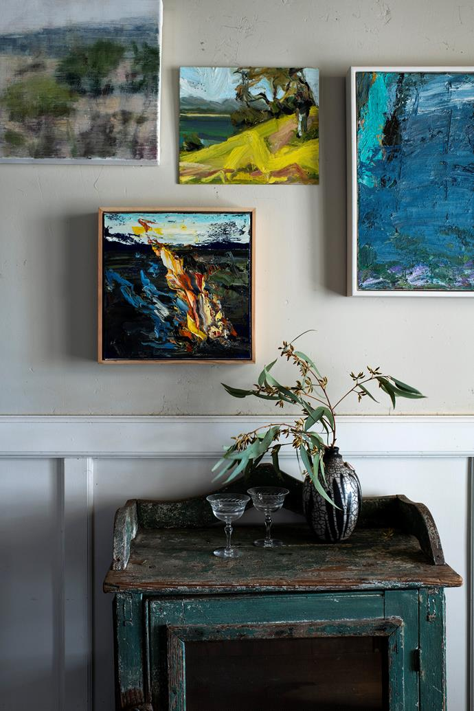 Clockwise from top left, artworks by Joanna Logue, Robert Malherbe, and Rowen from his Mountain Mist and The Flame on The Plain series. The vase is by Anna Henderson.
