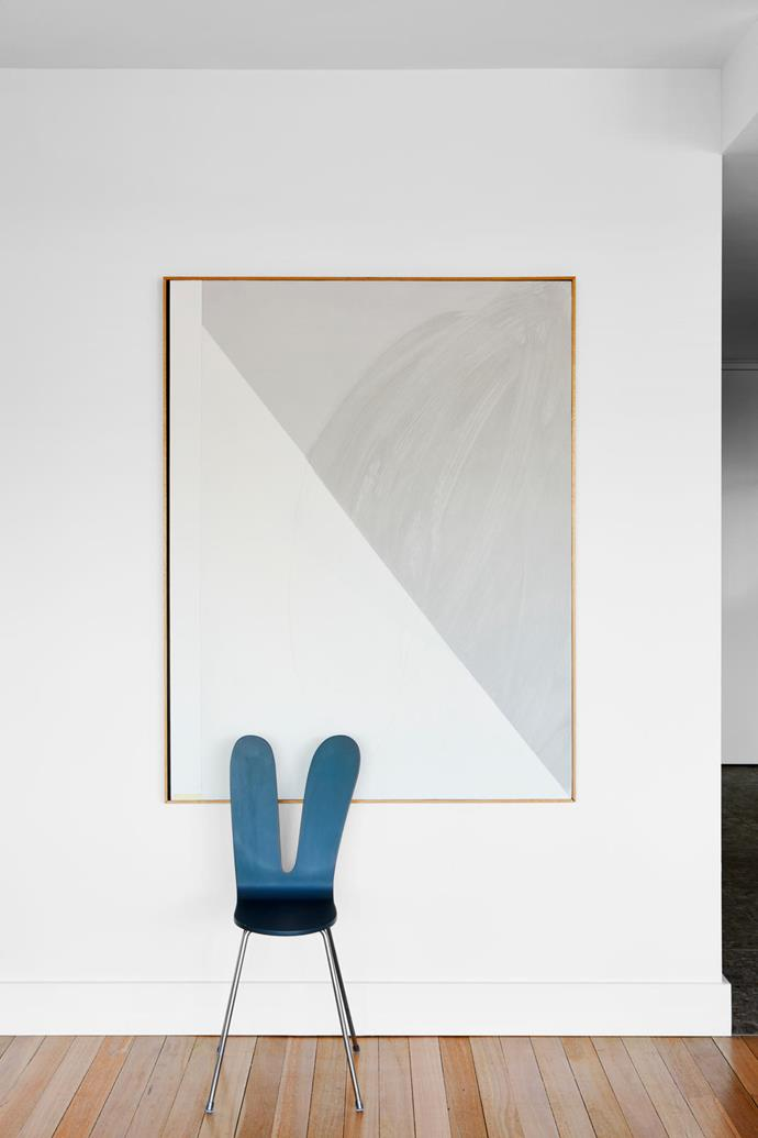 A 'Maruni' chair by Sanaa perches below a large artwork by Michael Bennett from Gallery9.