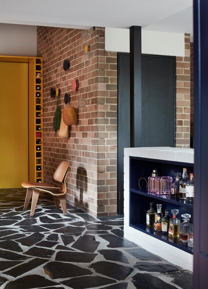"""""""An original rabbit warren-like floorplan saw the kitchen relocated from upstairs to the ground floor,"""" says designer Yasmine Ghoniem. Conventional layouts were rejected, with a custom brick plinth delineating the kitchen from the living area. This addition serves as an open liquor display, a reinvented kitchen island and integrated lounge."""