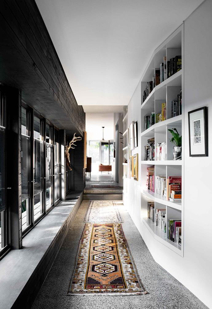 """**TAKE A STEP INTO THE DARK SIDE**<br><br>There's something classic about a white-on-white palette in the home, but we're making the case for taking a step into the dark side. A [dark feature wall](https://www.homestolove.com.au/dark-wall-ideas-18639