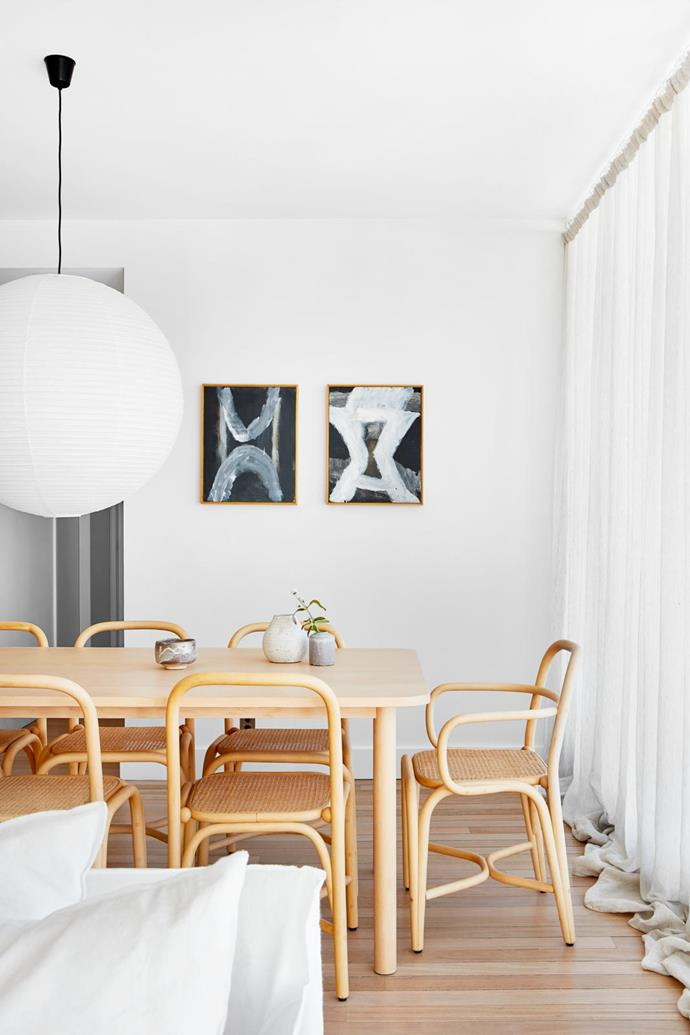 In the living area, Gervasoni 'Ghost' sofa, dining table by Mr and Mrs White and Expormim 'Fontal' chairs from Ke-Zu, beneath a '55A' pendant light by Isamu Noguchi. Artworks by Lottie Consalvo from Dominik Mersch Gallery.