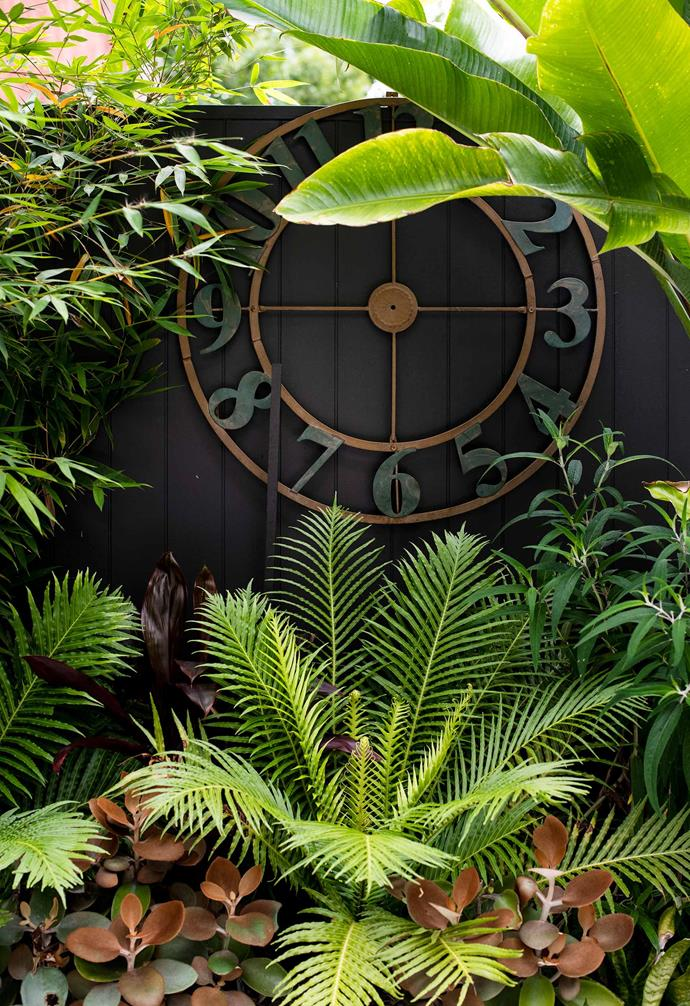 The metal outdoor clock was bought in Hobart by the owners.