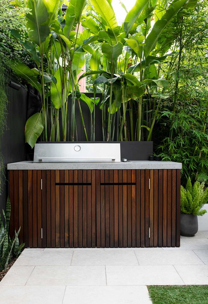 Perfect for frequent use, the discreet built-in BeefEater Signature ProLine barbecue, with spotted-gum doors and polished concrete benchtop, is tucked neatly into the side.
