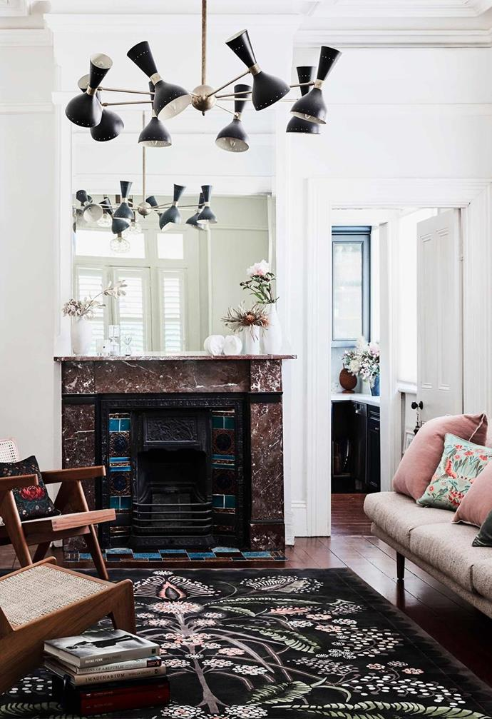 "The rich marble tones of this original fireplace mantle in an [1885 Italianate Victorian house](https://www.homestolove.com.au/italianate-victorian-home-19959|target=""_blank"") in Sydney's Annandale. The home, which belongs to homewares and past costume designer, Silvana Azzi Herasis, is filled with items crafted by its owner."