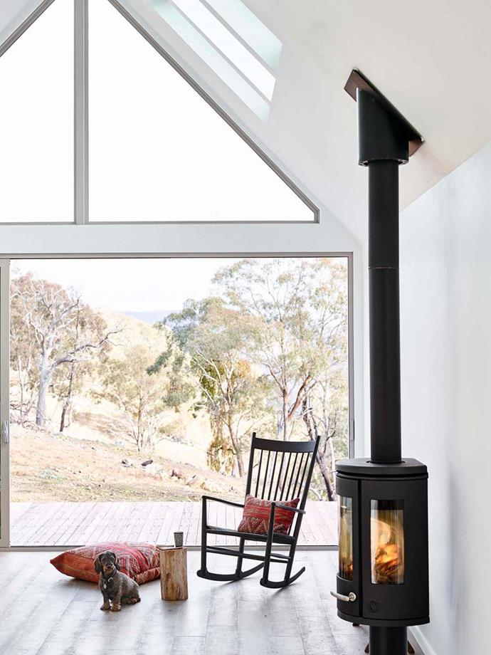 "The energy efficient fireplace by Morso in the living room warms up the entire living room of this [Danish-inspired cabin](https://www.homestolove.com.au/small-modern-cabin-20503|target=""_blank"") in the Lithgow Region of the Blue Mountains."