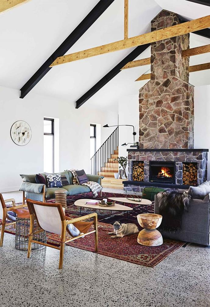 "The 'great room' of this [brand-new barnhouse](https://www.homestolove.com.au/country-farmhouse-17468|target=""_blank"") was everything owners Peter and Tracy love: relaxed entertaining with family and friends. The cathedral ceiling, along with a tonal mix of timber, and the striking stone fireplace create an open and inviting feel."