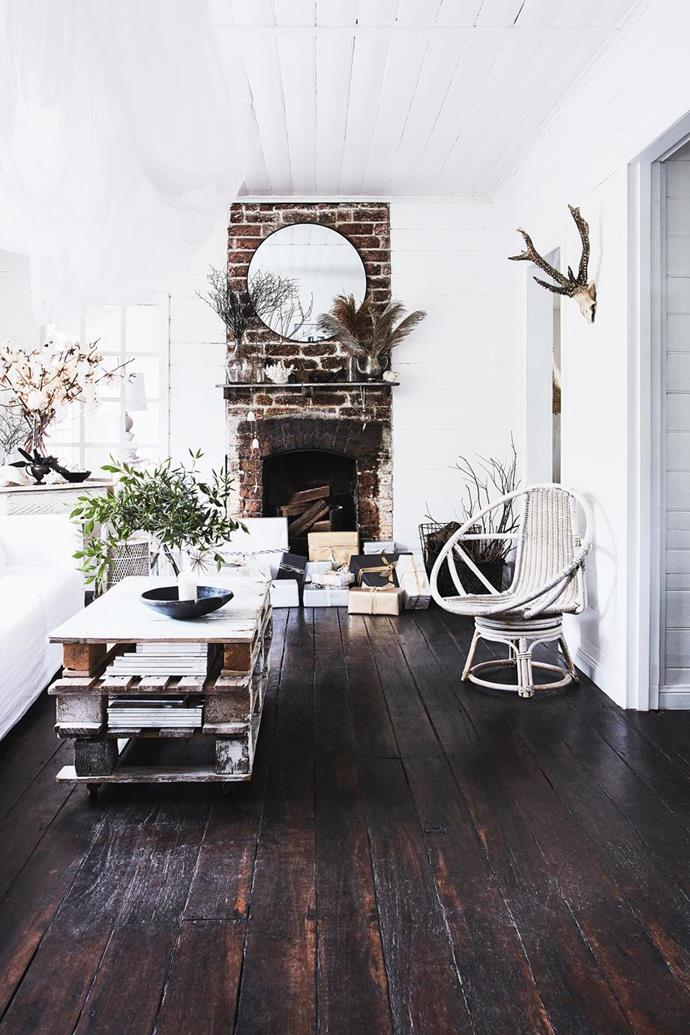 """The original brick fireplace is what first attracted the owners of this [historic home in the Kangaroo Valley](https://www.homestolove.com.au/the-cottage-kangaroo-valley-19551 target=""""_blank"""") and keeping it raw and rustic has created an idyllic country feel."""