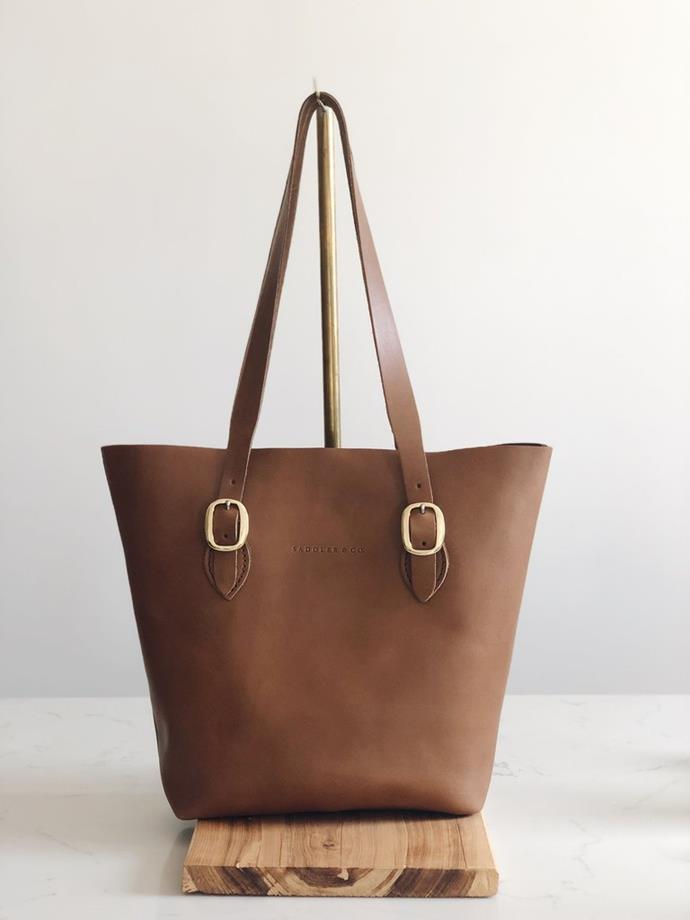 "The Classic Tote, $449, [Saddler & Co.](https://saddlerandco.com.au/collections/leather-bags/products/the-tote|target=""_blank""