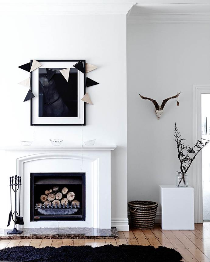"""An old [1920s home transformed into an idyllic country retreat](https://www.homestolove.com.au/1920s-house-renovation-new-zealand-13766 target=""""_blank"""") in rural New Zealand with an open-plan layout. A open fireplace in the living room adds the the laid-back ambience."""