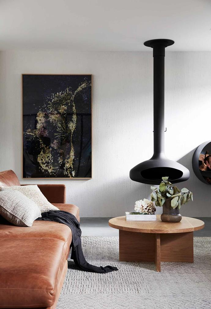 """A striking Hearth fireplace from Aurora Suspended Fires is balanced by the evocative Seaweed Pearls print by Kara Rosenlund, in this [luxurious new villa in Byron Bay](https://www.homestolove.com.au/barefoot-bay-villa-byron-bay-21018 target=""""_blank"""")."""