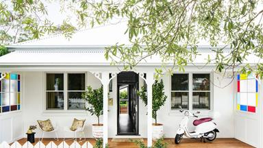 An all-white cottage with a glamorous interior