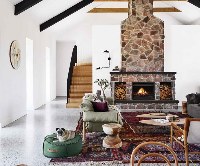 Double-sided fireplace in a country style kitchen