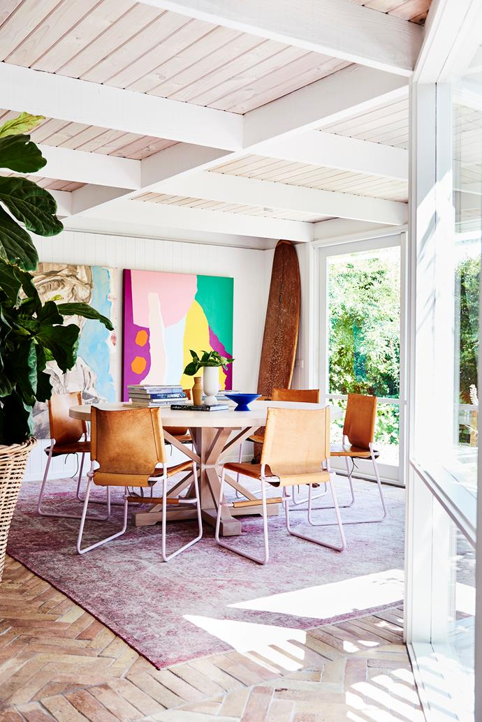 A Leah Bartholomew artwork hangs beside a David Bromley piece to create a gallery-worthy dining room (opposite). The MCM House dining table is teamed with leather Adam Lynch chairs on top of a rug from Halcyon Lake.