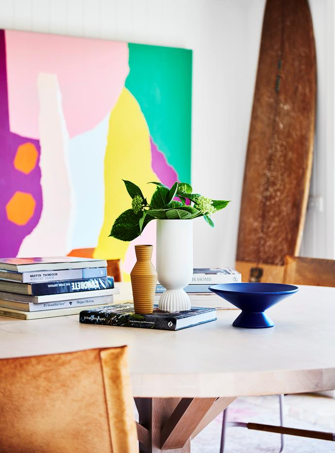 Style tip: Treat your dining table like you would your coffee table and style it with book stacks, interesting objects and candles to bring it to life