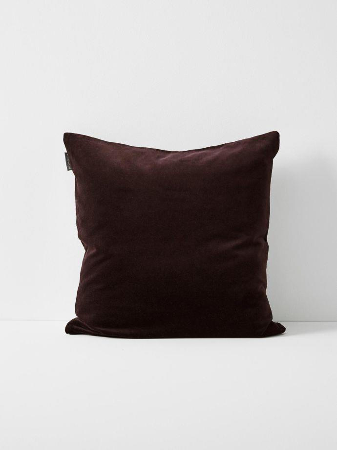 "Luxury Velvet Cushion in Fig, $59.95, [Aura Home](https://www.aurahome.com.au/luxury-velvet-cushion-fig|target=""_blank""