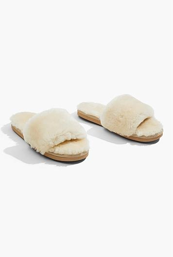 "Shearling Slide - Sand, $79.95, [Country Road](https://www.countryroad.com.au/shop/woman/shoes/slippers/60251759-119/Shearling-Slide.html|target=""_blank""