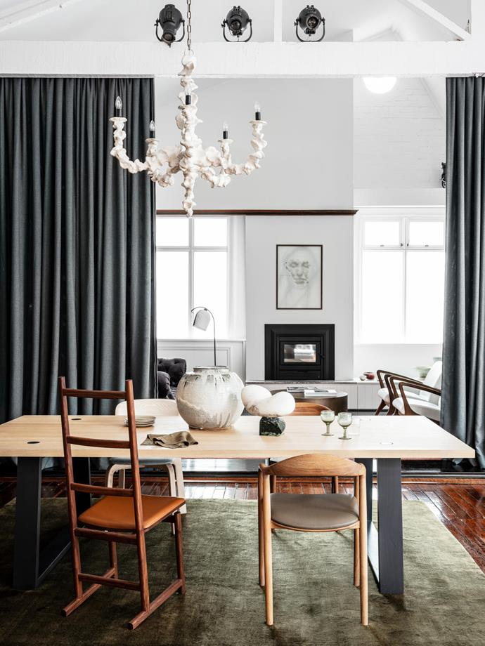 'Locator' dining table from Mark Tuckey. Artisan 'Neva', Neri & Hu 'Shaker' and Nichetto Studio 'Vivien' chair, Spence & Lyda. Hand-knotted rug from The Rug Establishment. Oly 'Klemm' chandelier from Coco Republic. Ceramic vessel from Planet, glasses and plates from Montmartre Store and 'Ariel' sculpture by Carol Crawford from .M Contemporary. Sitting area: Manér Studio 'Arc' floor lamp from Great Dane. Untitled, 2019 artwork by Laura Ellenberger from .M Contemporary.