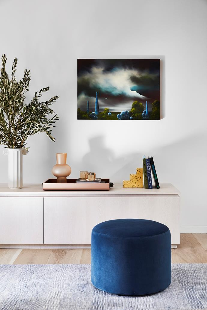 The custom console complements the existing joinery. HK Living vases and a Fenton & Fenton terrazzo bookend add sculptural appeal. The Blue Paradise artwork by Elaine Green speaks to the surrounding hues.