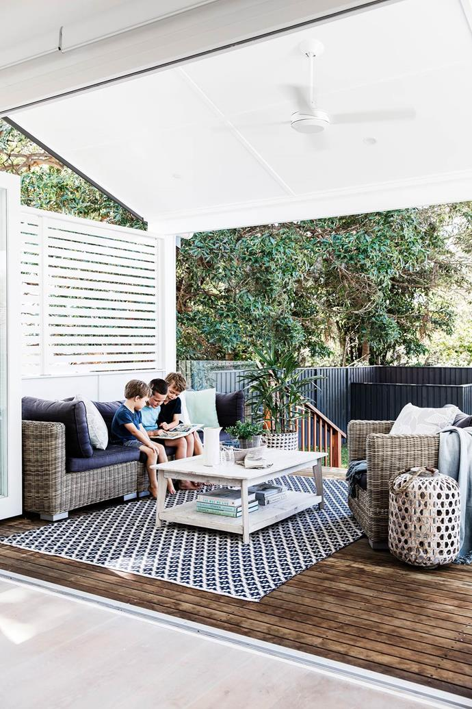 "Layering with rugs, throws and cushions helps make an outdoor entertaining area more cosy and inviting as seen with this elegant [living area](https://www.homestolove.com.au/serial-renovators-triumph-with-new-england-inspired-home-3034|target=""_blank"") conceived by *Your Beautiful Home.*"